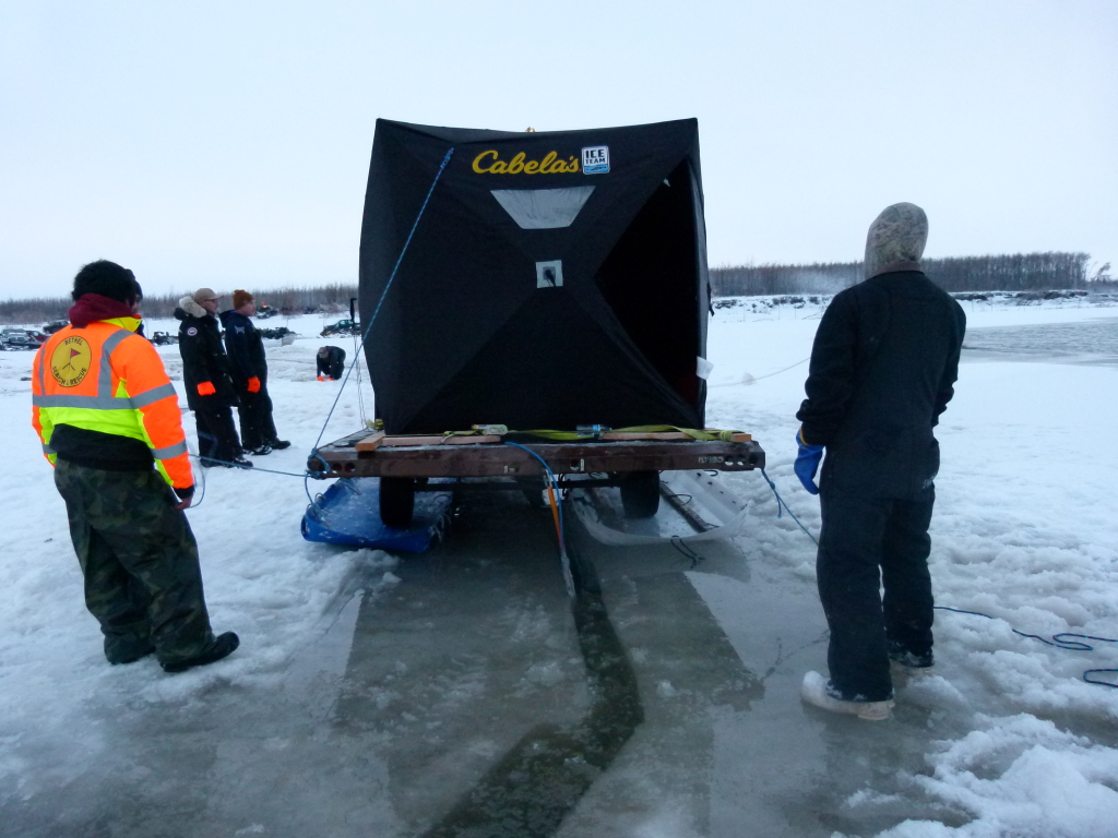 The sonar off the back and down through the ice to be towed near the bottom.